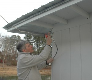 Spraying the eaves with the Milwaukee Tools airless paint system