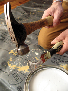 Use the gouge on Hyde's 10-in-1 Tool to pierce the gutter of the can all around the perimeter. The paint that used to gush over the side will simply drain back into the can.