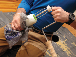 At the end of the day, throw away the roller cover. When trying to save it overnight, some little part of paint always dries or fuses to the roller frame and causes problems the next day.