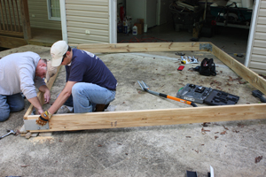 We began construction on the relatively flat driveway tokeep the rim-joist frame as square and level as possible.
