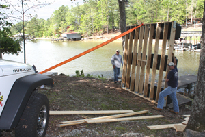 We used a Jeep equipped with a winch to help flip over the10x10' foot platform.