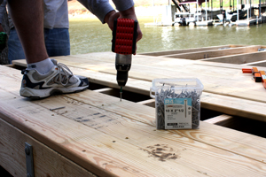 We fastened the 5/4 deck boards to the joists with stainless steel GRK deck screws, using two at every joist.