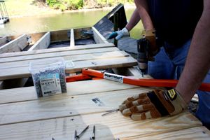 A BowWrench is a handy tool to straighten bowed decking boards.