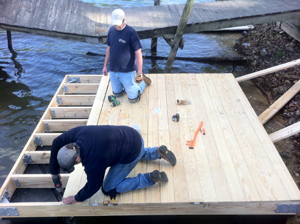 We installed about 1/3 of the decking to provide a working platform, and then launched the partially decked platform into the water so we would not have to contend with any more weight than necessary. Once in the water, we completed the remainder of the decking.