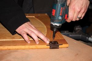 Always predrill the screw holes in hardwood to avoid splitting the wood.