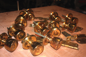 During a recent remodeling project, our staff replaced all the gaudy gold-tinted brass door hardware with brushed nickel knobs and hinges.