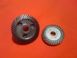 Extra tool durability is achieved in part by a larger grinder head (left) than the competition (right).