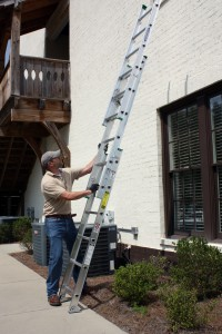 Folded, the Werner 16 ft extension ladder is only six feet long, short enough to fit in a truck bed without hangover