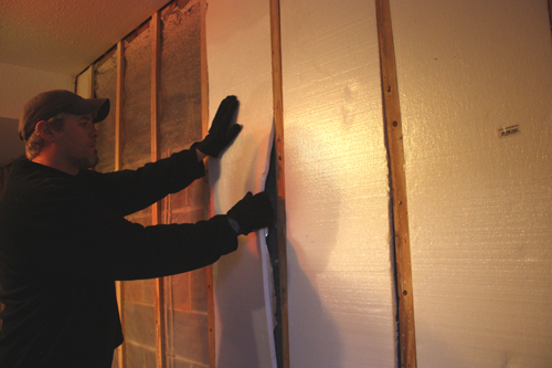 foam insulation can be cut to fit flush between the furring strips